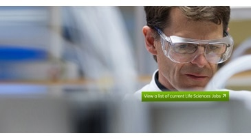 man wearing safety glasses in a GE Healthcare life sciences lab.